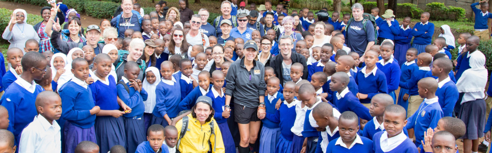 Large group of children and volunteers in Tanzania
