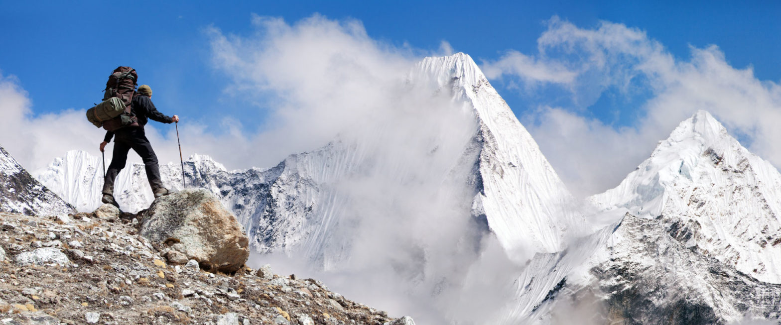 Climber overlooking Mt. Everest