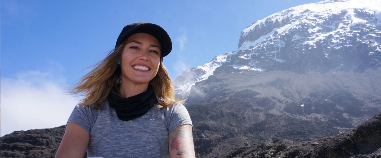 Traveler in front of Mt. Kilimanjaro